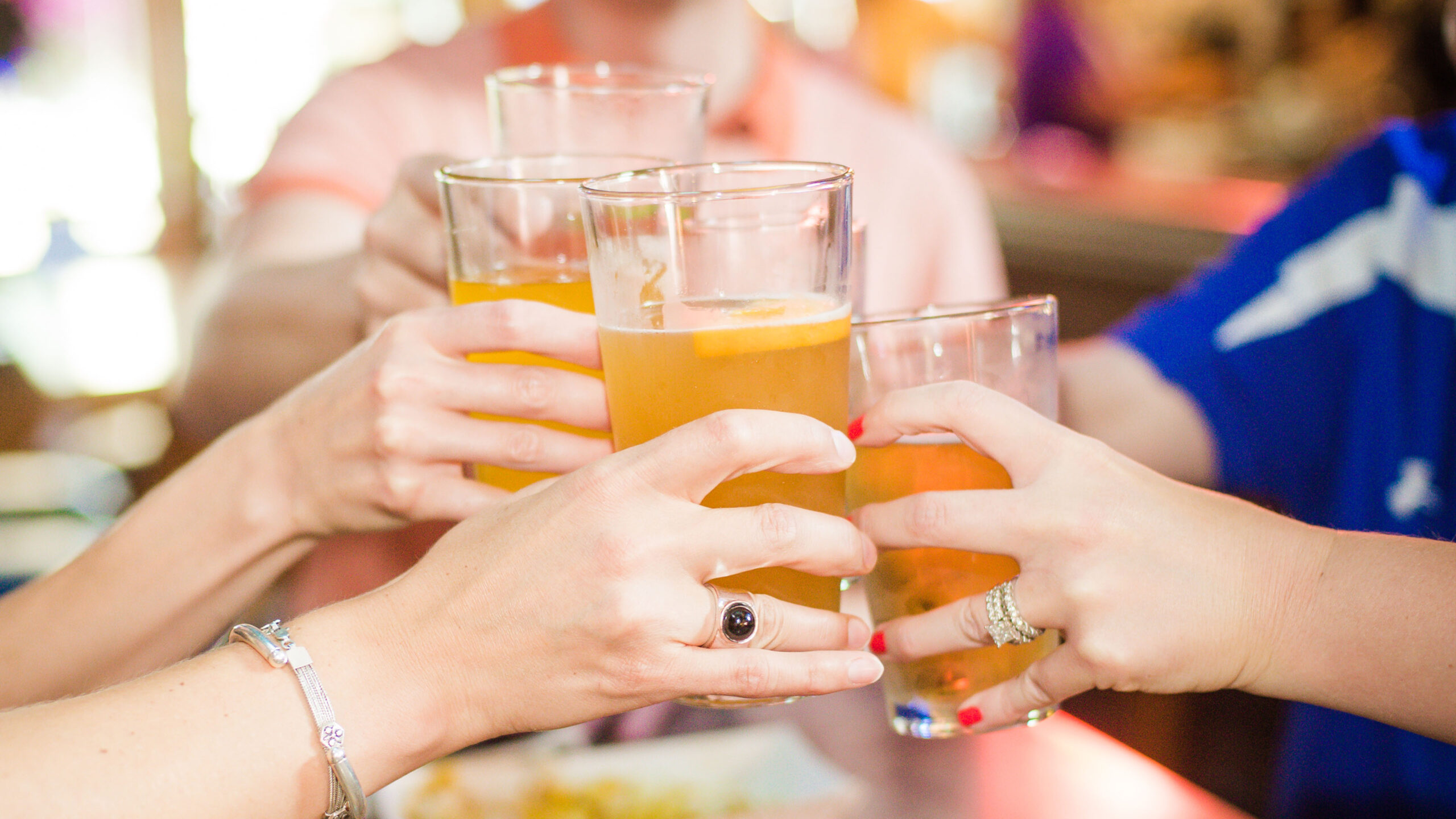 Women toasting cheers with beer glasses