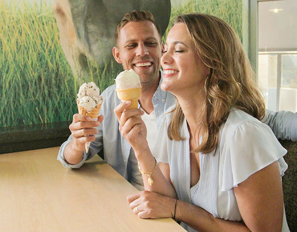 Young couple eating ice cream at SDSU Dairy Bar